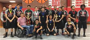 The Boys Weightlifting Team pictured with Caleb Rimes